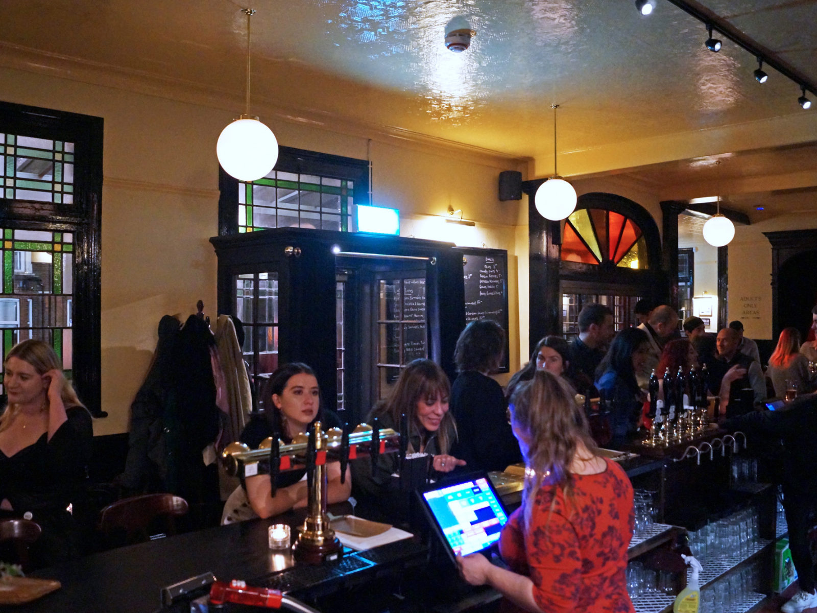 Customers ordering at the bar